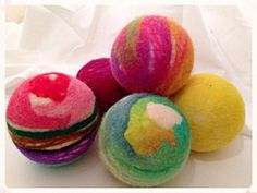 These dryer balls were inspired by those fun smelling bath bombs you drop in the tub! The playful colors make these perfect to add a splash. baabaablacksheepfelt.etsy.com