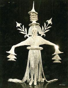 1910... space suit? Alien?