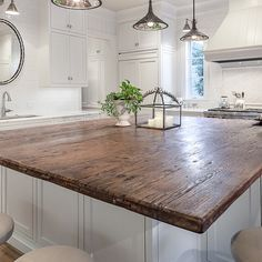 we like this top for a kitchen island (with a white base) - rather than choosing a non-white island as in the other picture.