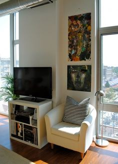 hacked ikea expedit as tv stand. Chair lighting plants small spaces