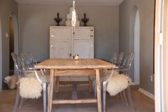 dinning room... love the mix of wood + lucite.