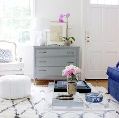 White and bright living room with a mix of different styles from french to contemporary to moroccan.