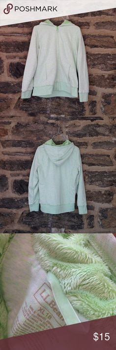 Green lined hoodie from L.L. Bean. L.L. Bean green lined hoodie. Lined with fleece. Super warm and cozy. It has pockets in the front. Girls size XL but could fit as a woman's XS. Great condition! L.L. Bean Shirts & Tops Sweatshirts & Hoodies