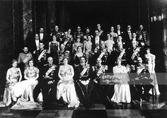 Celebration of Danish King CHRISTIAN X's 25 years of reign on May 18, 1937, at the castle of Christianburg in Copenhagen. For the occasion, the three royal families (of Denmark, Norway and Sweden) are photographed together after the banquet. First row : Princess INGRID of Denmark (2nd from left), King GUSTAVE of Sweden, Queen ALEXANDRINE of Denmark, King CHRISTIAN X of Denmark, King HAAKON of Norway and Princess INGEBORG of Denmark, the brother and sister of CHRISTIAN X.  (Photo by…
