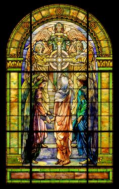 By Tiffany Studios ecclesiastical designer Frederick Wilson. Commissioned in 1901 by the Brainard family in memory of Waterville banker and hops merchant Charles Green, 'The Righteous Shall Receive a Crown of Glory' is remarkable for its large scale and for its integration of different types of glass and glass jewels, which the Tiffany Studios pioneered. Two angels escort the soul of the deceased up marble stairs toward a large cross supported by three angels and into the light of heaven.