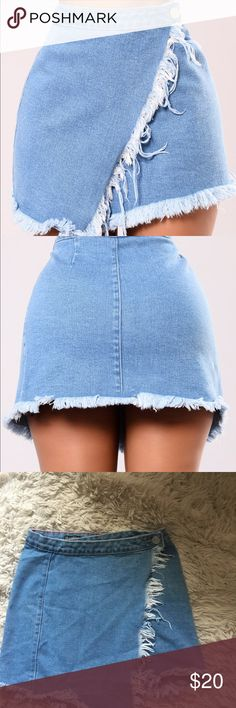 Fashion nova denim wrap skirt Size small, stretchy denim fabric. Goes a little longer than I expected more like mid thigh but is still cute and in good condition Fashion Nova Skirts