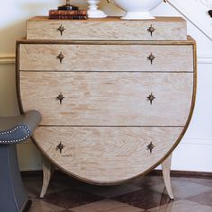 """This beautiful curved shaped chest is solid American white oak in a unique sandblasted finish. It has three functioning drawers with a nonfunctional stepped-in """"faux"""" drawer at the top. Each drawer ha"""
