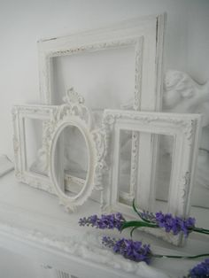 spray-paint ugly brass/garage sale frames white to get a coordinated look