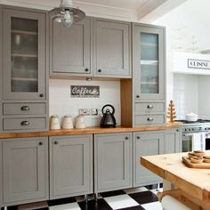 Grey cabinet with butcher block counter