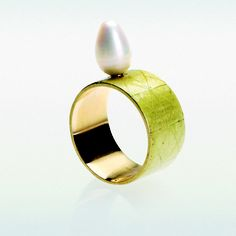 PHILIP SAGET  Gold, Enamel, Pearl.   A ring as simple as possible honoring the pearl.