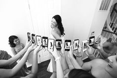 Cute idea a pic of all the bridesmaids taking a picture of the bride