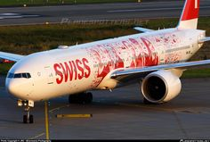 """Swiss International Airlines Boeing 777-3DE/ER (registered HB-JNA) in the """"Faces of Swiss"""" livery"""
