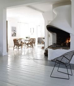 Would not mind a rounded open corner fire place like this one in Copenhagen.