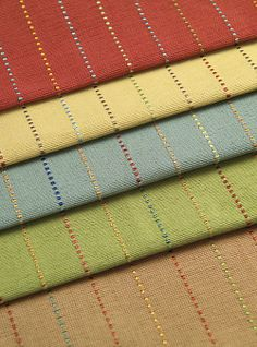 Pickering Stripe Fabric - A classic look with personality and flair. Contrast stitching adds flecks of unexpected color. Versatile, simple and cheerful. An easy choice for stress free decorating. 100% cotton