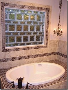 Glass blocks do not just have to be stacked one on top of another! In this bathroom window project a mixture of 4 x 8 and 8 x 8 blocks make a unique look and decorative window border. For more ideas visit - http://innovatebuildingsolutions.com/products/glass-block/basement-bathroom-windows