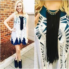 How adorable is this basic tank dress paired with a crochet tank? We absolutely loving this transition look