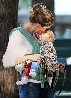 Gisele Bundchen gave baby girl Vivian a kiss on the forehead during an early morning walk in Boston on Aug.15,2013