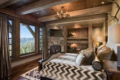 This cozy bedroom offers two built-in bunk beds, a warm fireplace and beautiful views of snow capped mountains. Description from design4interior.com. I searched for this on bing.com/images