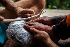 "Indonesian tattooists revive tribal traditions. December 5, 2015, a tattoo artist uses the traditional ""hand tapping"" method during a traditional tattoo festival in the village of Maguwoharjo located in Yogyakarta, Java's cultural heartland"