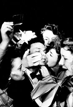 Frank Sinatra with his adoring fans, 1940s.