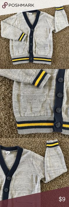"""Old Navy cardigan 📝 perfect for school uniform! Soft and cozy cardigan sweater for toddler boys or girls! Can match with school uniforms and perfect to pack along with your child on the way to school. Inner tag is marked with marker """"RJ"""", as this was once gently worn by my son 📚 Comes from a smoke and pet-free home. 🌺 bundle and save or make an offer 🌺 Old Navy Shirts & Tops Sweaters"""