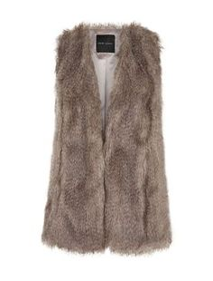 Spotted at LFW: Faux-fur cover-ups provided texture and warmth. Wear our Light Brown Faux Fur Gilet over shirts, knits and coats. £29.99 #NewLookStyle #LFW #streetstyle