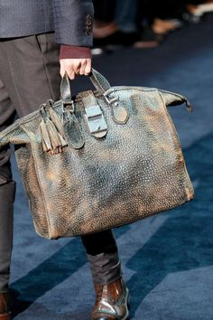 Gucci. Loving this distressed bag!!! It'd make a great weekender!