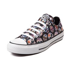 Get a head start with the sweet new All Star Lo Sugar Skulls Sneaker from Converse! These rad to the bone Chucks rock a sugar skull printed canvas upper with signature Converse rubber cap toe. <b>Available only at Journeys and SHI by Journeys!</b>  <br><br><u>Features include</u>:<br> > Low top style constructed with a sturdy canvas upper with breathable lining<br> > Lace-up closure<br> > Signature Chucks rubber cap toe offers protection and durability<br> > Converse rubber outsole provides…