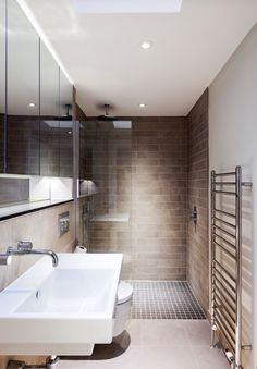 Beautifully simple modern bathroom with walk in shower. Deep rectangular shape.