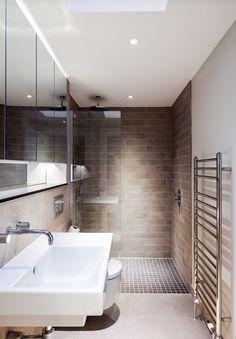 Beautifully simple modern bathroom with walk in shower. Deep rectangular shape.