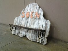 Wall mounted shelve, made from pallet wood, old desk trow away burglar bar pieces. This one if for sale.