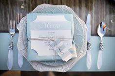 goes with the color scheme - Light Blue Place Setting Perfection! White table cloths, blue shades of tulle ribbon, satin ribbon and glittered bird cutouts. Pastel Blue Wedding, Wedding Colors, Wedding Reception, Our Wedding, Dream Wedding, Wedding Ideas, Wedding Things, Wedding Bells, Blue Table Settings