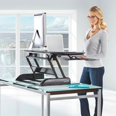 The Adjustable Height Sit / Stand Desk- made me think of Lisa A. who loves to work standing up.