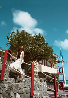 While Demarchelier has had a house on St. Barth's for years, Smalls—along with her deep V–cut sleeveless dress—is simply taking a thrilling temporary plunge. Céline dress with webbing, $3,600; Kirna Zabête, NYC. Giambattista Valli studded sandals. Shot on location at Eden Rock, St. Barth's.