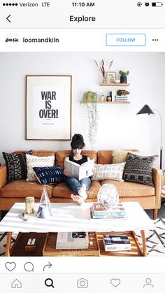 First off, I love the couch. It's modern, but it looks comfy. And second, I think the large picture with the smaller decor items would work well in our space.