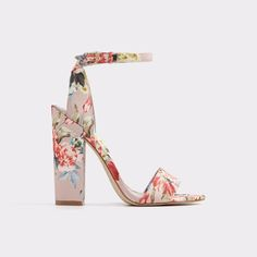 Miyaa A high- heel ankle strap sandal blooms with an eclectic bouquet of pastel flowers. Tap into its '70s-inspiration and punctuate swinging skirts and wide leg jeans with its vintage glamour.