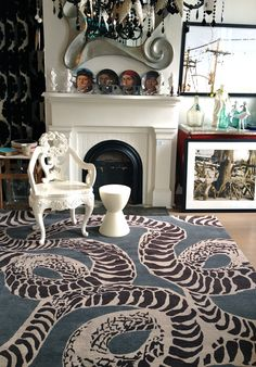 serpents rug by KW in an eclectic living room