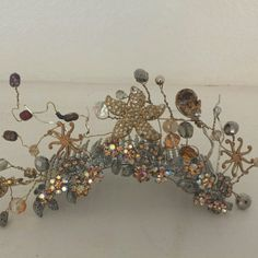 Featured mermaid bridal comb or tiara featured at The 5 star resort Montage boutique located near the Spa. Starfish crystals gold rose gold and hundreds of special intriquite bead work. Exclusively by Mona Lisa Mai bridal hair