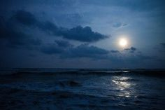 The moon above the ocean.