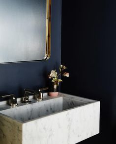 marble sink and brass mirror