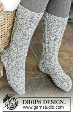 Waiting for Santa in warm and comfy socks. Make these for the whole family. Pattern available for free by #DROPSDesign