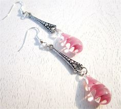 Pink swirled lampwork beads with silver connectors earrings. $18.00, via Etsy.