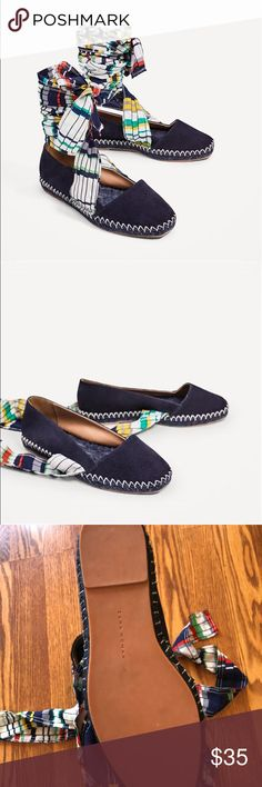 Zara lace up leather espadrilles flats ZARA WOMAN COLLECTION Lace-Up Real Leather Espadrilles Product Details: Navy blue flat leather shoes.  Braided jute detail with contrasting color top-stitching around the sole.  Multicolored lace-up fastening. Sole height 2.6 cm. / 1.0  Composition: UPPER 100% goat leather LINING 100% polyurethane SOLE 100% styrene butadiene rubber SLIPSOLE 55% polyester, 45% jute  Worn once just for a photo shoot, IN PERFECT CONDITION 💕  Size: 38 (7 1/2-8) Zara Shoes…