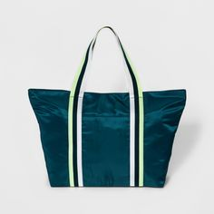 Perfect as a gym bag or beach bag, this Nylon Tote Handbag from A New Day™ makes a great versatile piece in your collection of accessories. The large frame is roomy enough for bringing a change of clothes with you after you're done working out, or taking your must-have essentials for a day of fun in the sun. With the zipper closure, you can feel safe knowing your belongings are kept secured inside the bag.