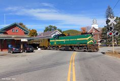 Green Mountain Railway Alco RS1 No. 405 chugs out of Chester, Vermont with an eastbound excursion train on Oct. 10, 2015. The temporary train rides ran between Chester and Rockingham, in addition to Chester and Ludlow, VT and return.