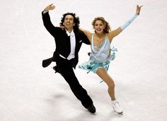 Tanith Belbin looks ready for a night on the town, on the arms of partner Ben Agosto, while the two skate away the evening at the the US Figure Skating Championships in January of 2010.