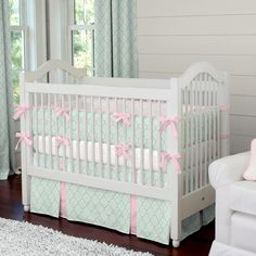 Mint and Pink Quatrefoil Crib Bedding by Carousel Designs.