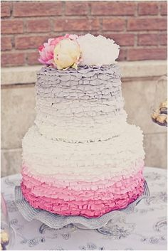 Ruffled ombre gray and pink wedding cake