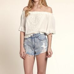 """NWT Hollister Off-the-Shoulder Lace Crop Top sz S Brand new and oh sooooo cute!!! Off-the-shoulder crop boho top. Beautiful chemical lace piece at center front (lace piece is fully lined). Cute ruffle detail at sleeve. Loose cinching at the bottom hem. This adorable top is a must-have staple for summer and festival season!!  Length=13"""". Hollister Tops Crop Tops"""
