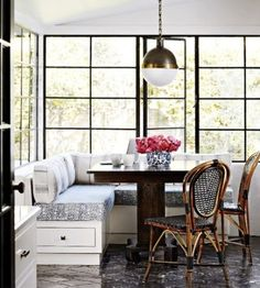 We love banquette seating, especially this gorgeous dining area.  Steel windows surround the kitchen nook.
